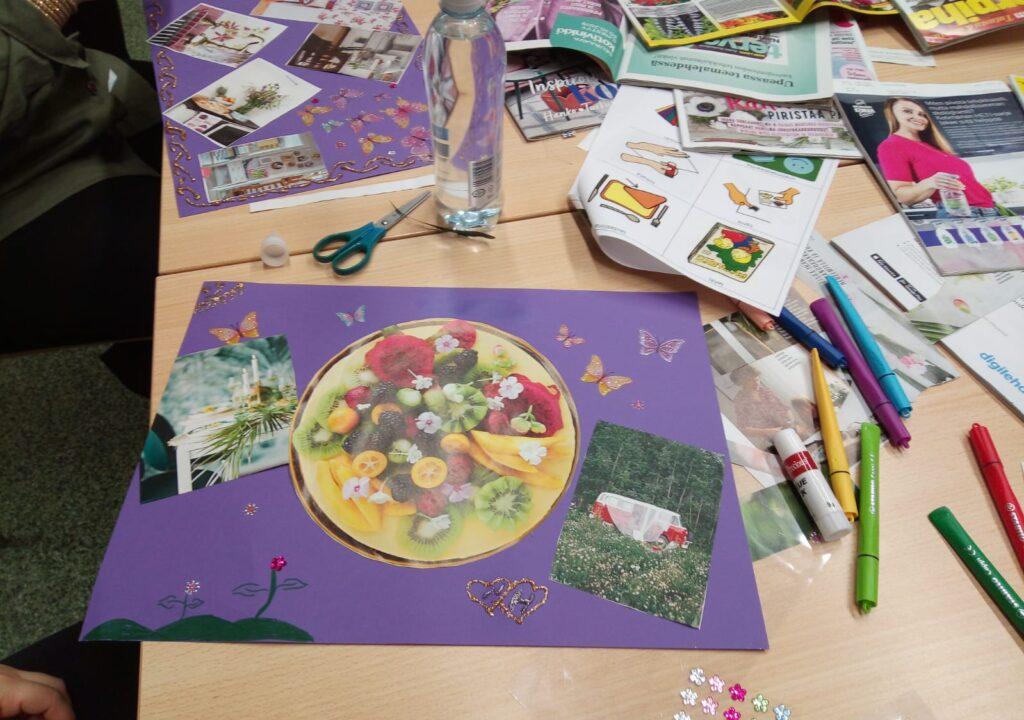 Valokuva, jossa pöydällä on värikkäitä askarreltuja kortteja.