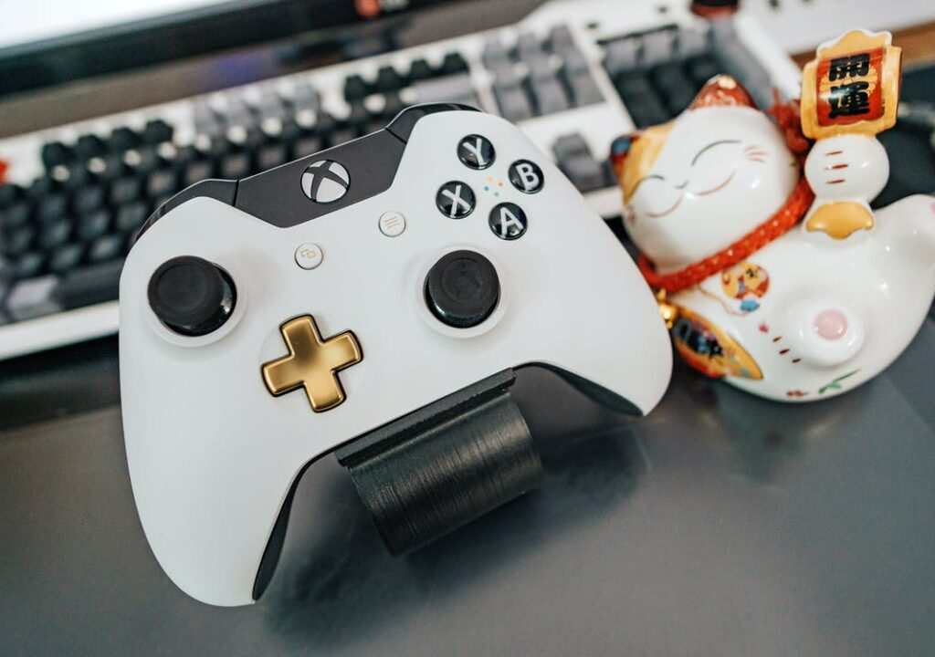 Xbox controller and a cute ceramic cat with Chinese character.