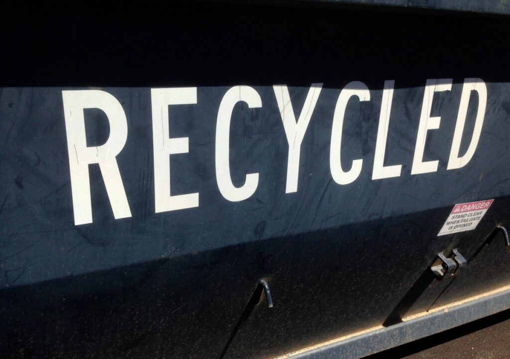 A black recycling vehicle