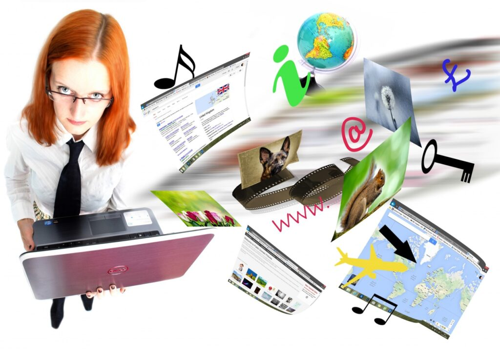 A woman with laptop in her hand. The photo also includes e.g. Web pages and photos.