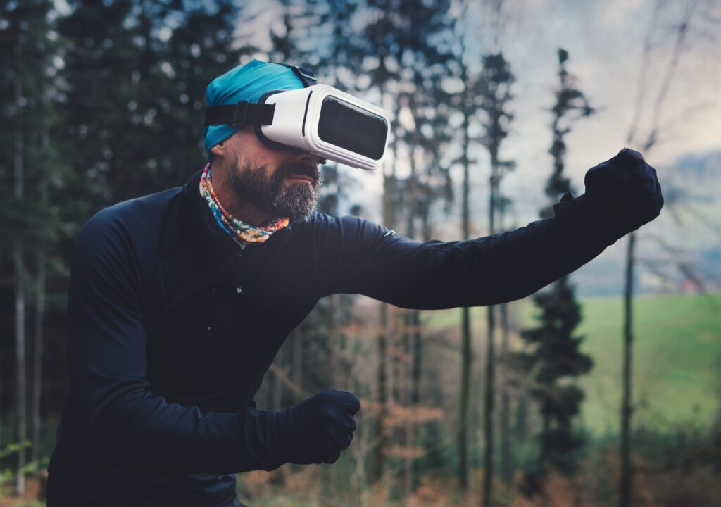 A person using VR headset in nature.