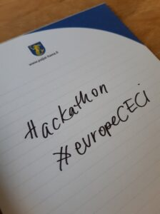 Notepad with the written text: hackathon and a hashtag #europeCECI